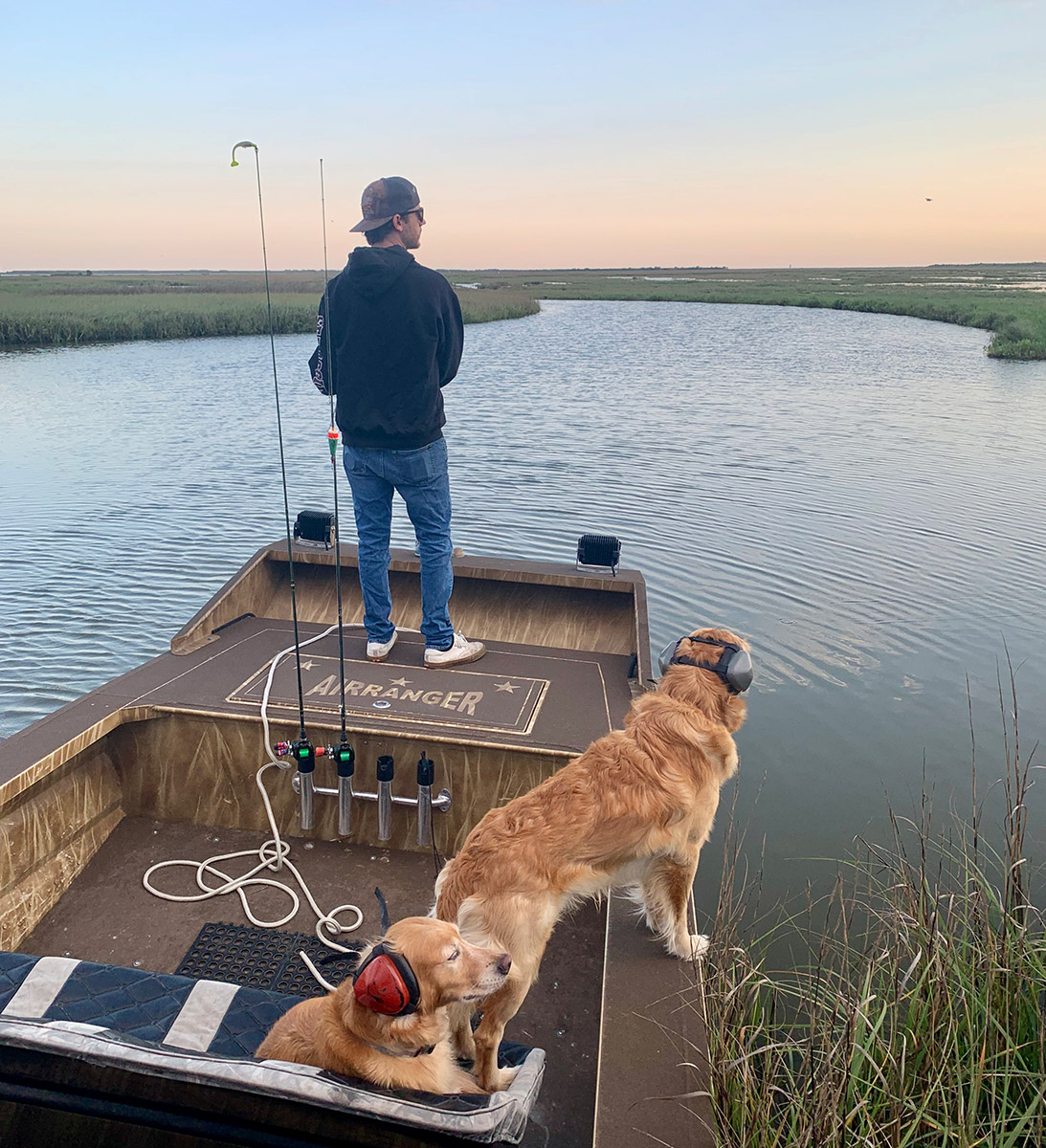 Shiner and Nattie watching Capt. James catch fish!